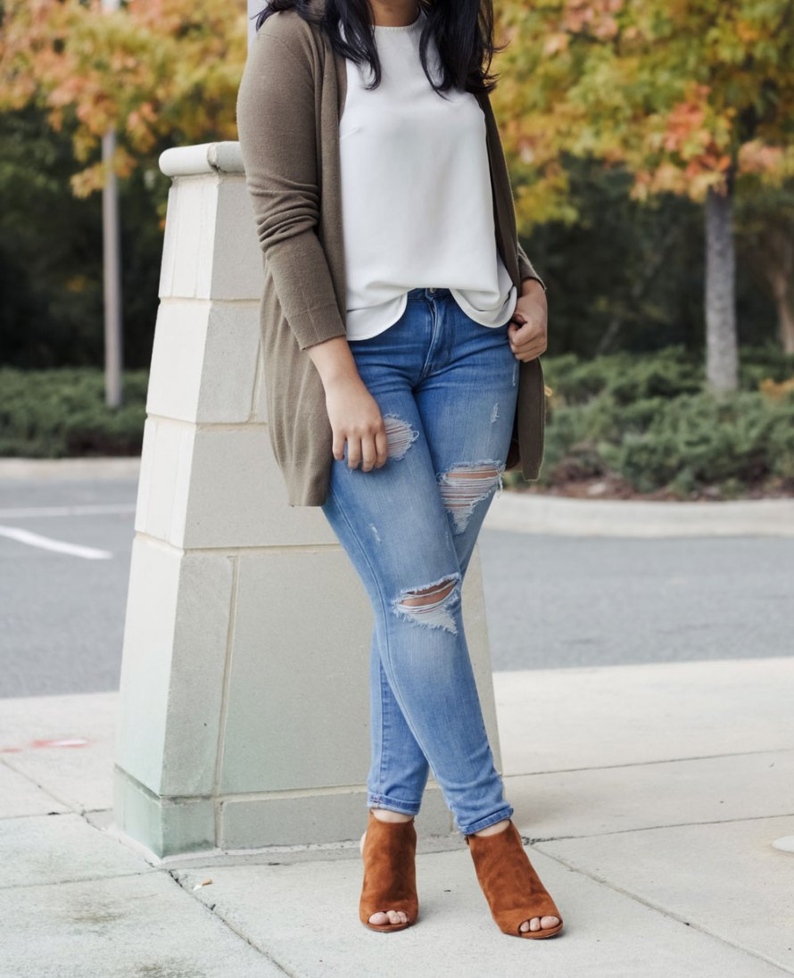fall colors outfit white top olive cardigan ripped jeans cognac shoes