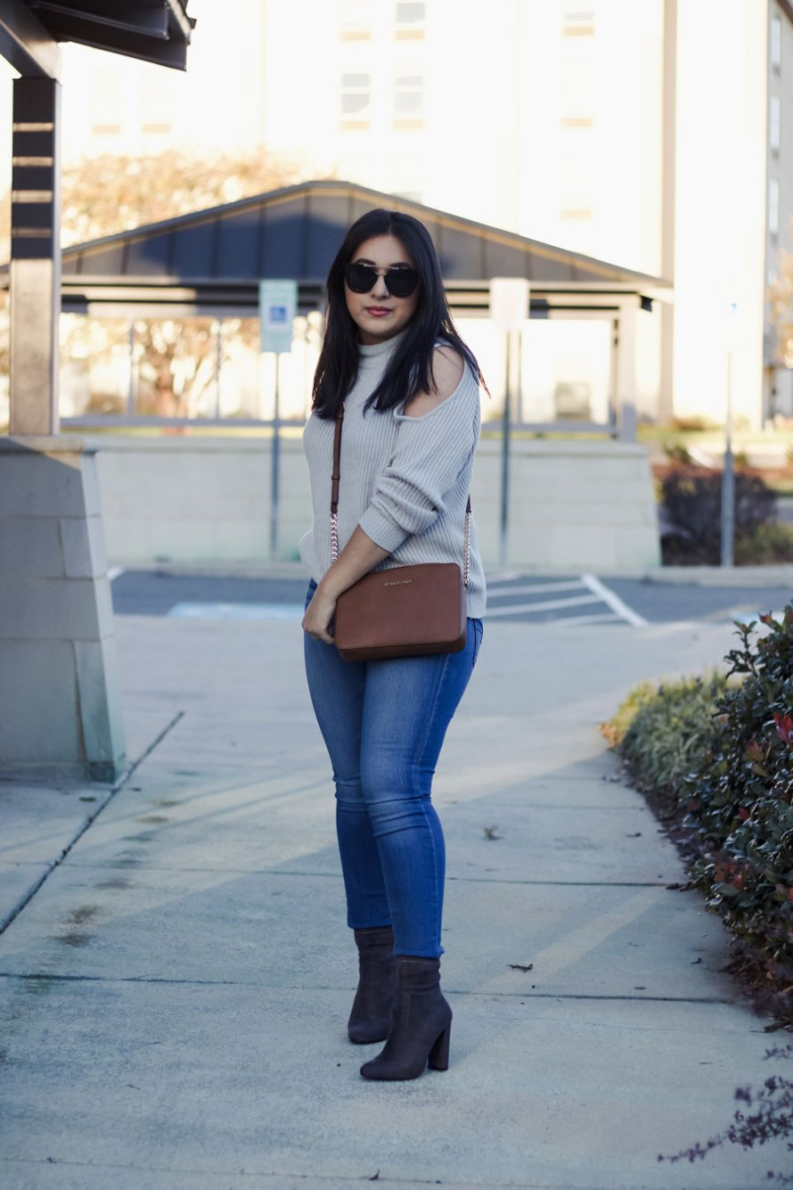 open shoulder sweater jeans boots casual fall outfit