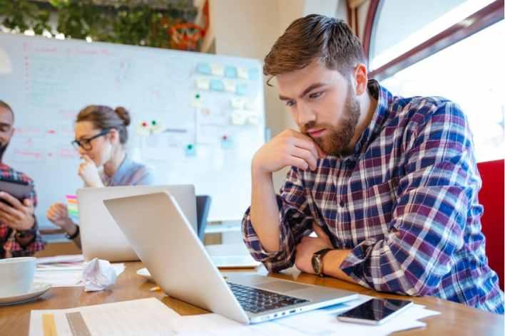 man taking paid online surveys to make money online
