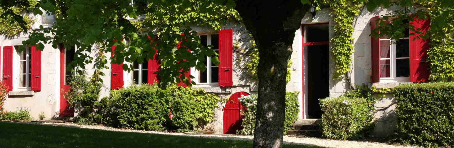 la maison aux volets rouges