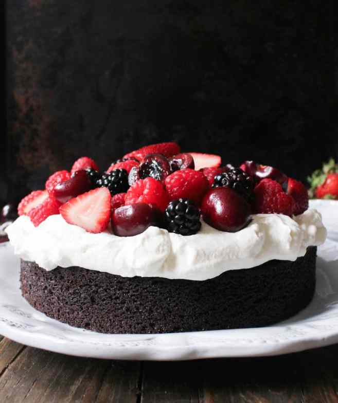 vegan-chocolate-cake-with-whipped-coconut-cream-and-fresh-berries