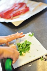 Chopping parsley for the braciola