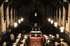 Chapel interior with brothers praying