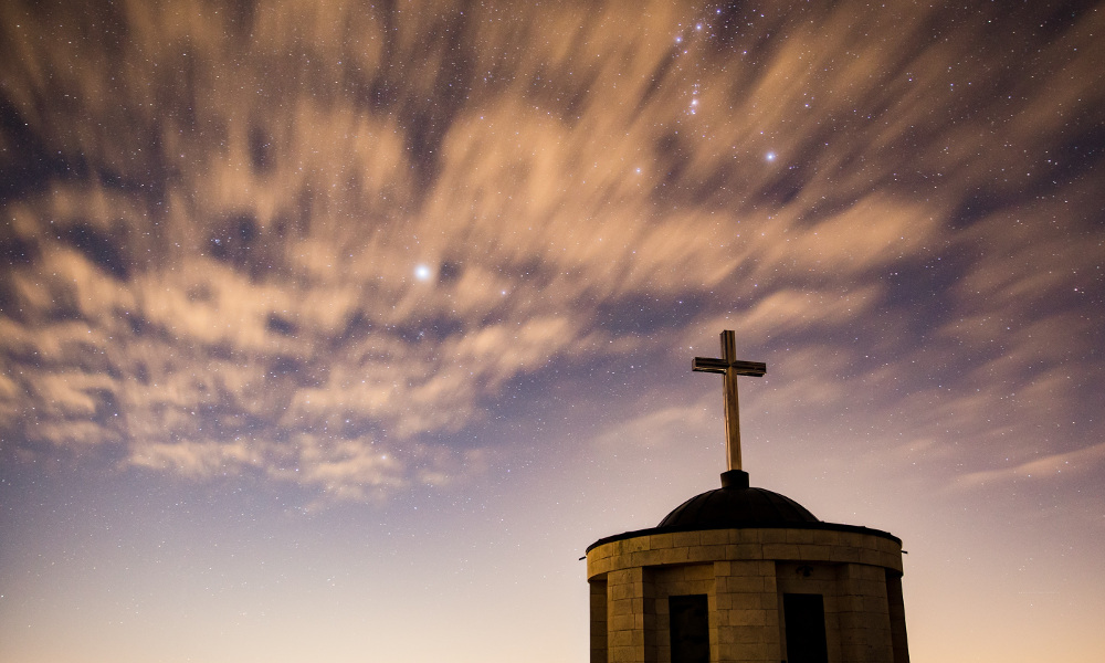 The roof of a church against the evening sky