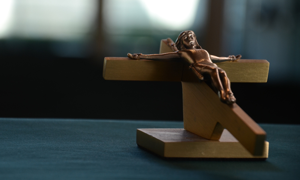 A crucifix on a desk