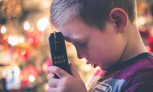 Child with Holy Bible