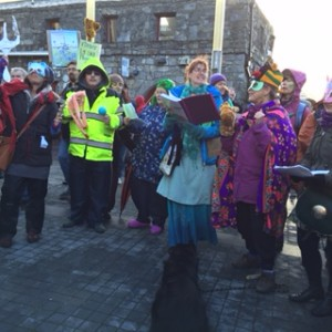 We need to build a better future and we need to start right now - the choir singing at the Climate Change demo Galway
