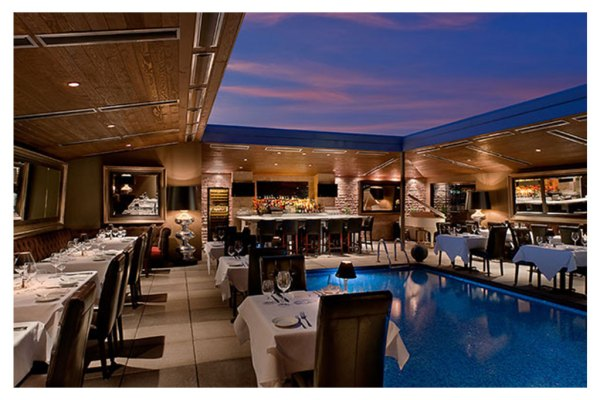 Dominick's steakhouse poolside dining at sunset
