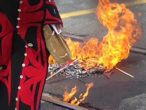 Canadian flags burn during Day of Action