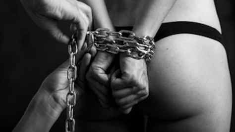 BDSM girl hands tied