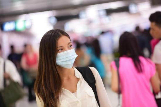 Woman wearing barrier mask