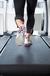 Woman walking on treadmill to achieve second wind