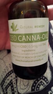 Bottle of CBD (cannabidiol) and THC (tetrahydro cannabinol) used by the father