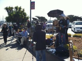 Painting shoulder to shoulder along Monterey Wharf