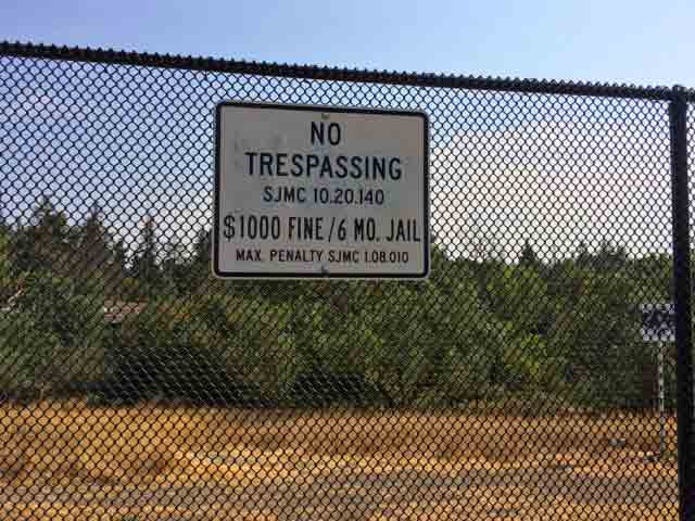 """A new fence was recently built around parts of """"The Jungle"""" with this ominous sign."""