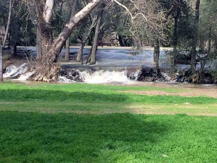 Water from the spillway flowing into the Coyote Creek channel