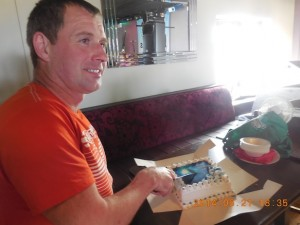 Diver Paul McCabe cuts his 44th birthday cake. He doesn't look a day over 43!