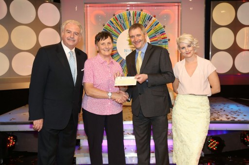 Marina Burns from Greencastle Co. Donegal won €45,000, including a car, on the National Lottery Winning Streak Game Show on RTE, on Saturday 31 May 2014. Pictured at the presentation of the cheques were, from left to right: Marty Whelan, game show co-host; Marina Burns, the winning player; Declan Murray, The National Lottery and Sinead Kennedy, game show co-host. Pic: Mac Innes Photography