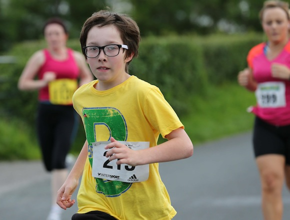 A young lad taking part in the Sessiaghoneill NS 5K Fun Run & Walk on Thursday evening. Pic.: Gary Foy, newsandsportfiles