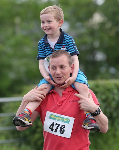 Former Twin Towns Lord Mayor Barry Dowds has a passenger for good measure as he takes part in the Sessiaghoneill NS 5K Fun Run & Walk. Pic.: Gary Foy, newsandsportfiles