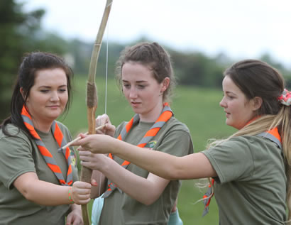 It takes three scouts to shot a bow during a demonstration of archery at the Beaver Scout Camp.  ((c) North West Newspix)