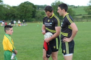 Michael Murphy and Rory Kavanagh sign a ball for a stunned young fan!