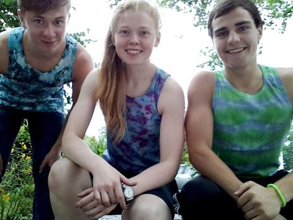 Sab, pictured with two friends wearing her colourful t-shirts
