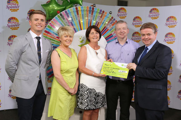 Monica McDonagh from Letterkenny, Co. Donegal won €21,500, including a Smart TV, at the National Lottery's Money Spinner event held at National Lottery offices in Dublin on Saturday 5 July 2014. Pictured at the presentation of winning cheques were, from left to right: Brian Ormond, Money Spinner Host; Pauline McLaughlin, National Lottery ticket selling agent, Mac's Book & Newsagents, Upper Main Street, Buncranna, Co. Donegal; Eileen Dolly, the winning player; Eunan McLaughlin, National Lottery ticket selling agent, Mac's Book & Newsagents and Brendan McGrenra, The National Lottery.  Pic: Mac Innes Photography