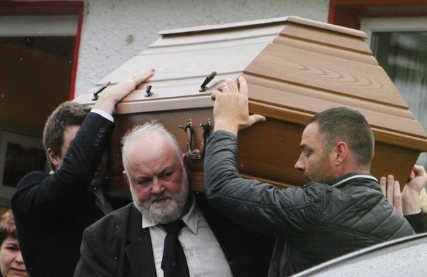 Patrick McLaughlin (left) helps bring his son Enda to his final resting place.