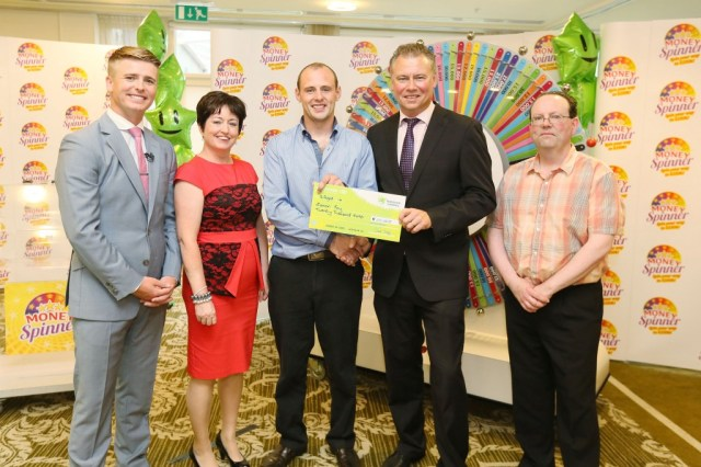 Pictured at the presentation of winning cheques were, from left to right: Brian Ormond, Money Spinner Host; Jacqueline Floyd, ticket selling agent, Floyd's, Main Street, Co. Donegal; Eamon Foy, the winning player; Dermot Griffin, Chief Executive, The National Lottery and Paul Floyd, ticket selling agent.  Pic: Mac Innes Photography