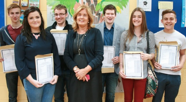 Crana College teacher Mary Galbraith pictured with her Leaving Cert Irish class after they received their excellent results.