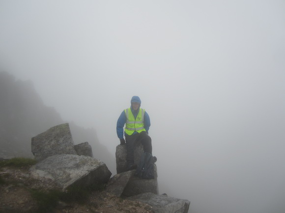 A Donegal Mountain Rescue Team member on Errigal today as rain lashed down