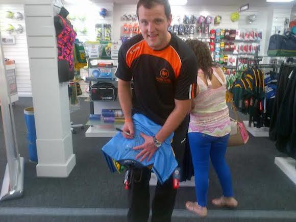 Michael at his new sports store in Letterkenny adds his signature to the back of Danny O'Carroll's Dublin jersey