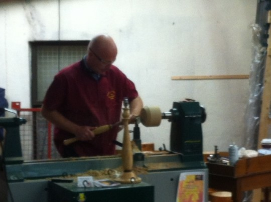 Robert O'Connor demonstrating expert woodturning today at the exhibition at W.H. Raitt.