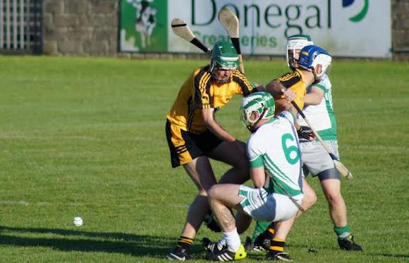 Justin McGee and Anthony Patton (Mac Cumhails) contest possession with Conor McVeigh and Colm Breathnach (St. Eunan's)