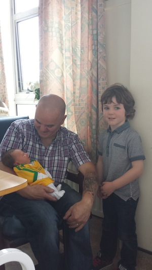 Baby Daithi is spoiled by his grandfather Brian Grant and cousin Oisin Higgins