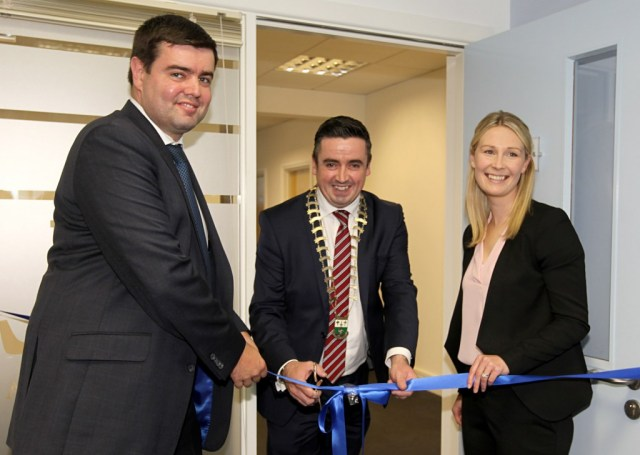 Gerard Grant Chairman of Letterkenny Chamber cuts the tape to oficially open Nathaniel Lacy Partners Solicitors new offices at the Riverside Centre, Letterkenny with l-r t Nathaniel Lacy and Jill Grant (solicitor).