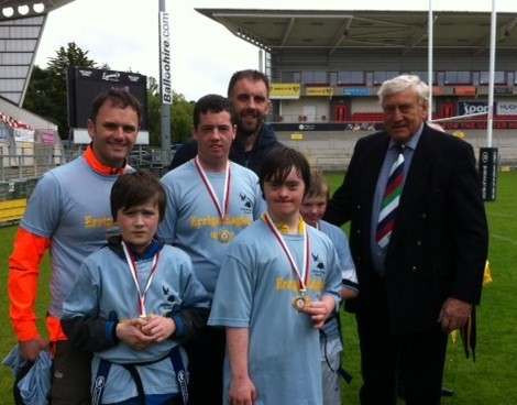 Errigal Eagles players Conor McDermott, Aaron McLaughlin, Paul Gallen and Cian Baird with coaches Pat McDermott and Gerry Doherty meeting rugby legend Willie-John McBride at the recent tag festival at Ravenhill