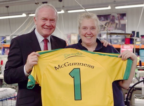 Martin McGuinness stitching a Donegal jersey together, under the supervision of Kieran Kennedy, managing director, and staff member Josie Friel,from Lifford, during his visit to O'Neill's in Strabane. Photo: Lorcan Doherty Photography