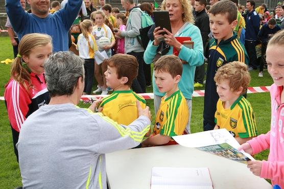 Donegal Manager Jim Mc Guinness signs some new players at the fans day in Ballybofey. Photo Brian McDaid