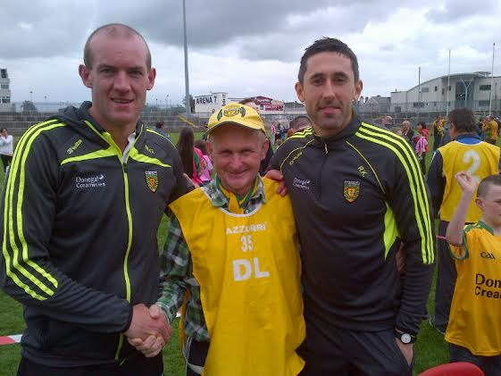 Michael Gallagher pictured with county players Rory Kavanagh and Neil Gallagher at the open day on Saturday where the postman was a steward
