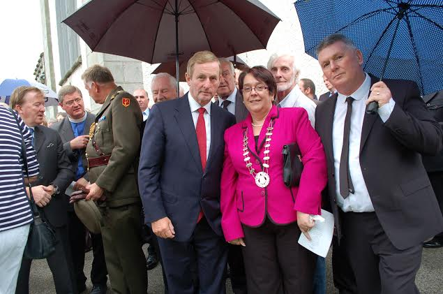 An taoiseach Enda Kenny with Donegal Town Mayor; Patricia Callaghan and husband Vincent at the graveside