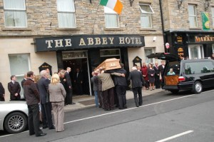 Jim's remains are taken into the Abbey for the wake today: Pic Paul O'Sullivan