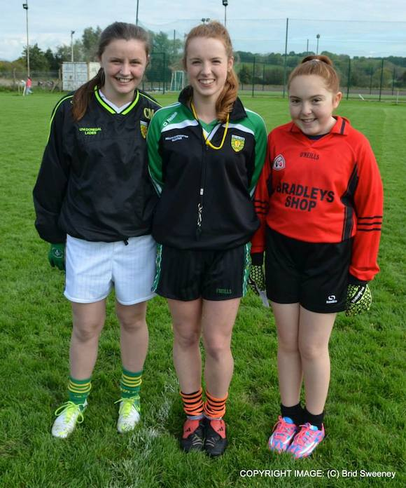 The captains of Red Hughs and Naomh Muire with Junior Ref Aideen Meehan at Pairc Cholmcille on Saturday. Pic Brid Sweeney