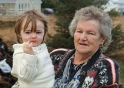 Ann Boyle with one of her grandchildren. Pic courtesy of RTE.
