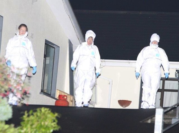 Officials from the State Pathologist's office at the couple's home last night. Pic copyright of North West News Pix.