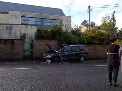 The badly-dmaged Ford car which was also involved in the crash.