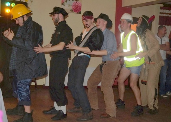 The huge crowd in Friel's could barely contain their excitement when these lads from the Raphoe Town FC team appeared as The Village People for the last act of the night.