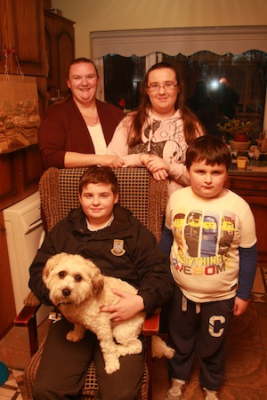 Harry the family pet gets in for the photo with the Nesbitt family Dillion Ethan Kelly and Marie pictured at their home , Wiinner of the 1st week prize in the Cristeph Studio and Donegal Daily Portrait Competition.  Photo Brian McDaid