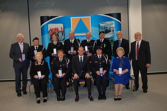 Photo caption: Back Row, L-R, Mr. Joe Breslin, Mountcharles (30yrs), Mr. James Dolan, Stranorlar (40yrs), Ms. Anne Marie Monagle, Glengad (30yrs), Mr. Hugo Boyle, Carrigart (30yrs), Mr. Denis Gallagher, Burt (30yrs), Mr. John Quinn, Ballybofey (30yrs), Mr. Brian Spain, Director for Civil Defence, Dept of Defence, Mr. Bill Smith, Director General, Civil Defence, Roscrea Front Row, Ms. Rose Mc Namee, Letterkenny (40yrs), Ms. Jackie Mc Crudden, Burt (30yrs) Mr. Paul Kehoe, The Minister for State at the Department of Defence, TD, Ms Edel Flynn, Ballybofey, Civil Defence Officer (30yrs), Ms. Ita Wilkie, Letterkenny (30yrs)